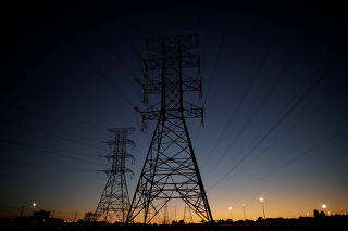 Power lines connecting pylons of high-tension electricity are seen in Brasilia