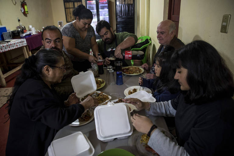 A family meal of Chinese takeout at the Ruiz family?s taco restaurant in San Cristóbal de las Casas, Mexico.