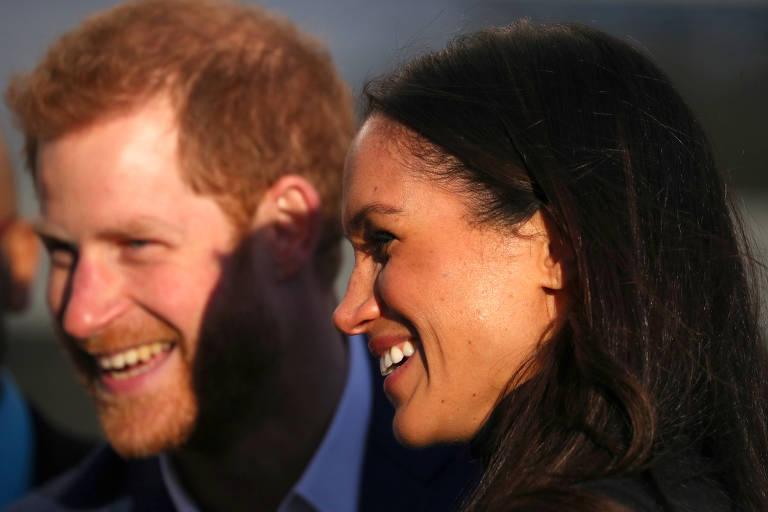 Príncipe Harry e Meghan Markle durante visita a escola em Nottingham