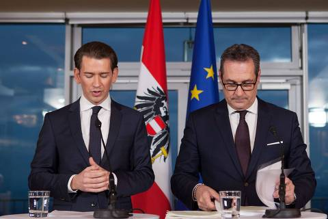 Future Austrian Chancellor Sebastian Kurz (L) of the conservative People's Party (OeVP) and incoming vice-chancellor Heinz-Christian Strache of the far-right Freedom Party (FPOe) give a joint press conference to unveil their joint programme on December 16, 2017 in Vienna, Austria. Austria's far-right has secured the interior, defence and foreign ministries in the new coalition government with the conservatives, Freedom Party (FPOe) head Heinz-Christian Strache said. Kurz's OeVPy will have the finance, economy and justice ministries, Kurz said. / AFP PHOTO / ALEX HALADA
