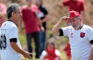 Former Brazil President Luiz Inacio Lula da Silva and Brazilian singer and writer Chico Buarque attend a charity soccer match at Florestan Fernandes school in Guararema