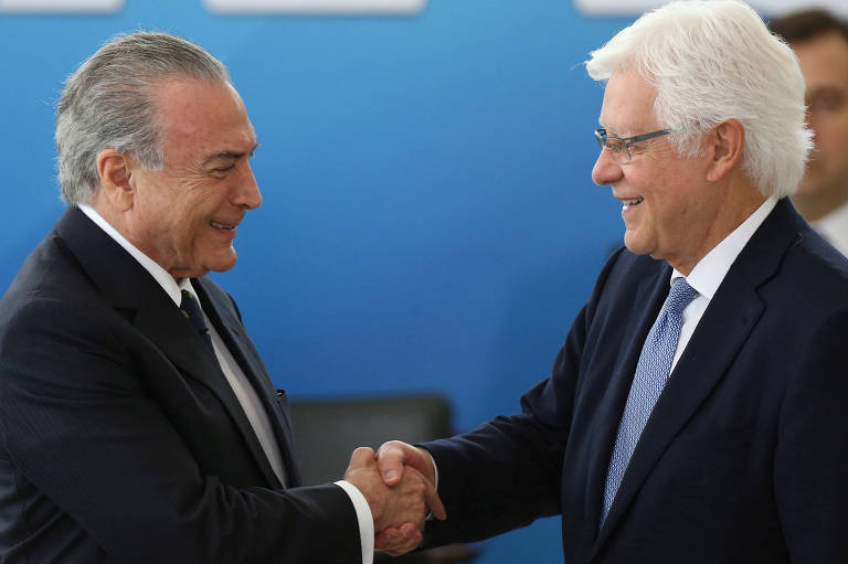 Brazil's President Michel Temer greets the Minister of the General Secretary of the Presidency of Brazil, Wellington Moreira Franco during  the inauguration ceremony of the new Ministers, at the Planalto Palace in Brasilia