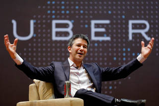 FILE PHOTO: Uber CEO Kalanick speaks to students during an interaction at IIT campus in Mumbai
