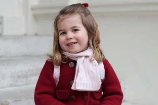 Britain's Princess Charlotte sits on the steps at Kensington Palace in a photograph taken taken by her mother and handed out by Britain's Prince William and Catherine, the Duchess of Cambridge