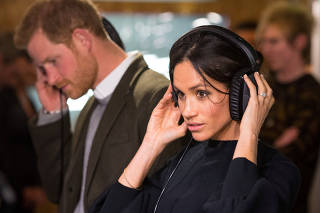 Britain's Prince Harry and his fiancee Meghan Markle visit radio station Reprezent FM, in Brixton, London
