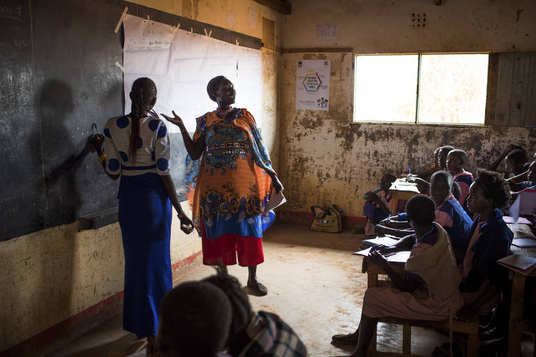 Maasai girls attend an education program about their rights and the risks of female genital cutting, in Lenkisem, Kenya, Dec. 7, 2017. As a young girl, Nice Leng?ete hid to avoid the mutilation.
