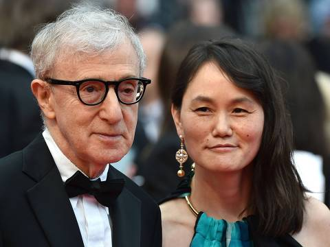 (FILES) This file photo taken on May 11, 2016 shows US director Woody Allen and his wife Soon-Yi Previn as they arrive for the screening of the film