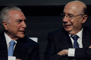 Brazil's President Michel Temer talks with Brazil's Finance Minister Henrique Meirelles during an event Caixa 2018 of Caixa Economica Federal bank in Brasilia