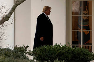 U.S. President Donald Trump walks to the Oval Office of the White House upon his return in Washington