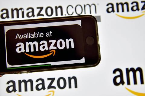 (FILES)  This file photo taken on December 28, 2016 shows the logo of US electronic commerce and cloud computing company Amazon in Vertou, France. US online shopping giant Amazon on February 5, 2018 announced it had struck a deal with the French government to settle a bill for nearly 200 million euros ($249 million) in unpaid taxes. / AFP PHOTO / LOIC VENANCE ORG XMIT: LVE2601