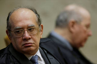Judge Gilmar Mendes reacts during an opening session of the Year of the Judiciary, at the Supreme Court in Brasilia