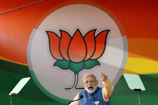 India's Prime Minister Narendra Modi addresses an election campaign rally ahead of the Karnataka state assembly elections in Bengaluru