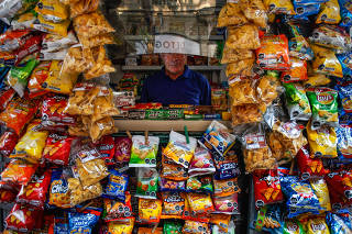 A kiosk where many snacks bear the black warning logos denoting items high in sugar, salt, calories or saturated fat, in Santiago, Chile.