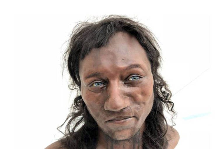 Representação de como seria o Homem de Cheddar, com pele negra e olhos azuis