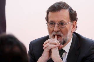 Spain's Prime Minister Mariano Rajoy attends a meeting in Madrid