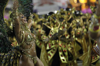 Drum queen Viviane Araujo from Salgueiro performs during the second night of the Carnival parade at the Sambadrome in Rio de Janeiro