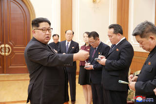 North Korean leader Kim Jong Un meets members of the high-level delegation of the Democratic People's Republic of Korea which visited South Korea to attend the opening ceremony of the 23rd Winter Olympics