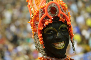 A reveller from Salgueiro performs during the second night of the Carnival parade at the Sambadrome in Rio de Janeiro