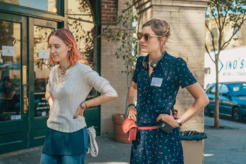 This image released by A24 Films shows director Greta Gerwig, right, and Saoirse Ronan on the set of