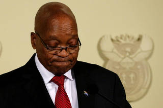 South Africa's President Jacob Zuma looks down as he speaks at the Union Buildings in Pretoria