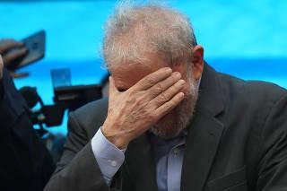 FILE PHOTO: Former Brazilian President Luiz Inacio Lula da Silva reacts during a rally in support of his candidacy for the 2018 presidential race, in Porto Alegre