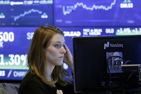 A Nasdaq employee works at her computer at the Nasdaq MarketSite, in New York, Wednesday, Feb. 14, 2018. Stocks climbed Wednesday for the fourth straight day, and the S&P 500 has trimmed its loss to 6.1 percent from its record high, set on Jan. 26. (AP Photo/Richard Drew) ORG XMIT: NYRD146