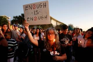 Mourners hold vigils in Florida town after 17 killed in high school shooting
