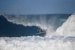 Surfer Joel Parkinson competes during the Billabong Pipe Masters at the Banzai Pipeline in Pupukea on the island of Oahu