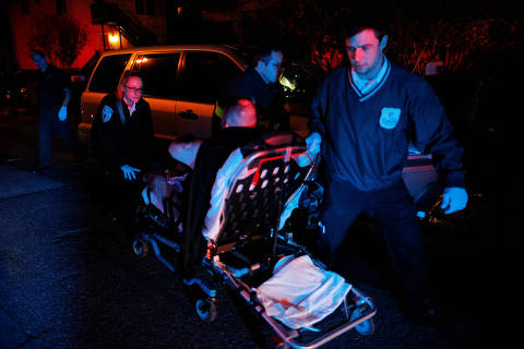 Cataldo Ambulance medics Paula Gageiro (L) and Al Driscoll (R) take a man in his mid-40's, who was found unresponsive and not breathing in his car after overdosing on opioids, to an ambulance in the Boston suburb of Revere, Massachusetts, U.S., November 8, 2017. The man showed signs of withdrawal in the ambulance after being revived with 8 mg of naloxone. In response to repeated questions from the patient about what had happened, Gageiro replied,