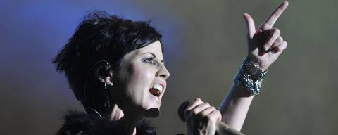(FILES) This file photo taken on July 07, 2016 shows Irish singer Dolores O'Riordan of the Irish band The Cranberries performing on stage during the 23th edition of the Cognac Blues Passion festival in Cognac on July 7, 2016. 