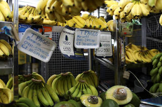 Information for Vippo app and other methods of payment is seen in a fruit and vegetables stall at Chacao Municipal Market in Caracas