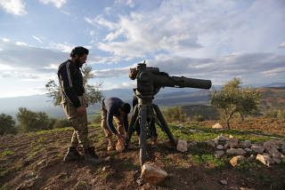 Turkish-backed Free Syrian Army fighters prepare a TOW anti-tank missile north of the city of Afrin