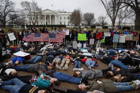 Demonstrators participate in a