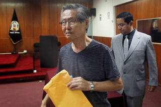 FILE PHOTO: Peru's former President Alberto Fujimori arrives in court during the sentencing in his trial on charges of embezzling state funds to manipulate the media during his tenure as president, in Lima
