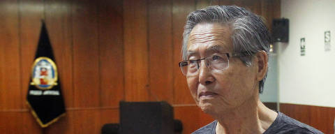 FILE PHOTO: Peru's former President Alberto Fujimori arrives in court during the sentencing in his trial on charges of embezzling state funds to manipulate the media during his tenure as president, in Lima, Peru January 8, 2015. REUTERS/Enrique Castro-Mendivil/File Photo ORG XMIT: LIM105