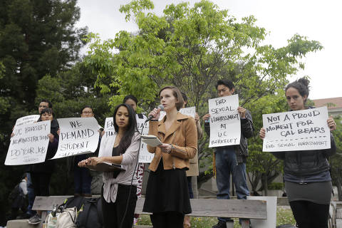 University of California graduate students Erin Bennett, center right, and Kathleen Gutierrez, speak at a news conference on the campus in Berkeley, Calif., Monday, April 11, 2016. Bennett and Gutierrez have filed a complaint regarding alleged sexual harassment by a University of California Berkeley professor. (AP Photo/Jeff Chiu)  ****FOTO COM CUSTO**** ORG XMIT: CAJC103