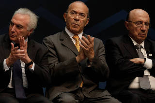 Brazil's Temer, Chief of Staff Padilha and Finance Minister Meirelles attend ceremony near Rio de Janeiro