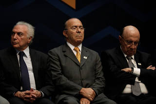 Brazil's President Temer, Chief of Staff Padilha and Finance Minister Meirelles attend ceremony near Rio de Janeiro