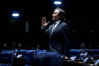 President of the Federal Senate Eunicio Oliveira reacts during a session to vote on a decree on federal intervention in the security of Rio de Janeiro, in Brasilia