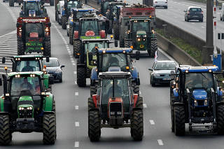 French farmers drive their tractors on the A7 highway to protest changes in underprivileged farm area?s mapping and against Mercosur talks, in Solaize