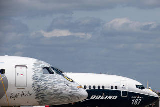 FILE PHOTO: A Boeing 737 MAX and an Embraer E190-E2 are seen on the static display, before the opening of the 52nd Paris Air Show at Le Bourget airport near Paris
