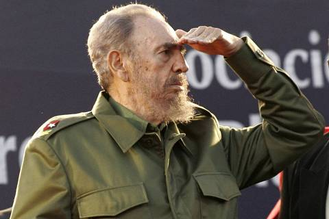 ORG XMIT: 244401_1.tif Cuba's President Fidel Castro looks at the crowd during a mass rally in Cordoba, Argentina in this July 21, 2006 file photo. To match story WITNESS CASTRO REUTERS/Andres Stapff/Files (ARGENTINA)
