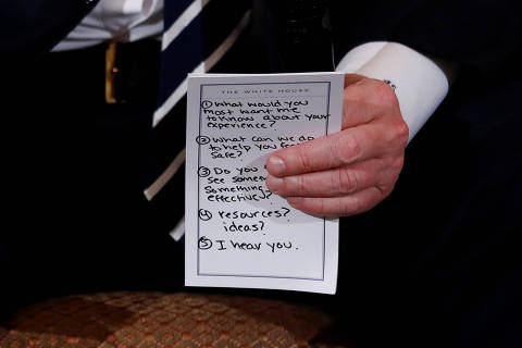 U.S. President Donald Trump holds his prepared questions as he hosts a listening session with high school students and teachers to discuss school safety at the White House in Washington, U.S., February 21, 2018. REUTERS/Jonathan Ernst ORG XMIT: WAS917