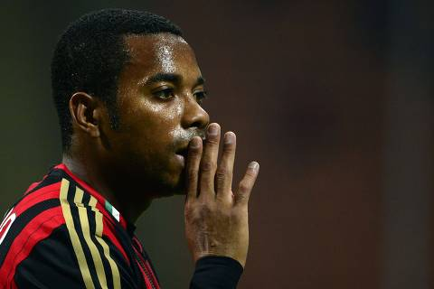 (FILES) This file photo taken on September 28, 2013 shows AC Milan's Brazilian forward Robinho during the Italian Seria A football match AC Milan vs Sampdoria, on Septembre 28, 2013, in San Siro stadium in Milan. A Milan court on November 23, 2017 sentenced former AC Milan and Brazil forward Robinho aka Robson de Souza Santos to nine years in jail for gang raping a 22-year-old Albanian woman in a Milan disco on January 22, 2013.  Robinho, who is now playing for Brazil team Atletico Mineiro, was found guilty of committing the rape with five other people. / AFP PHOTO / Olivier MORIN ORG XMIT: OLM639