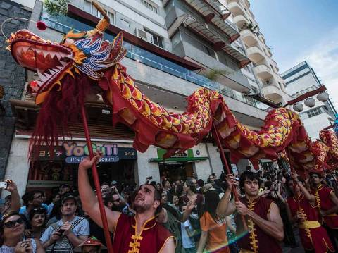 The dragon dance is performed during celebrations to mark the Chinese Lunar New Year, which welcomes the Year of the Rooster, at the Liberdade district in Sao Paulo, Brazil, on January 28, 2017. / AFP PHOTO / NELSON ALMEIDA ORG XMIT: NAL001