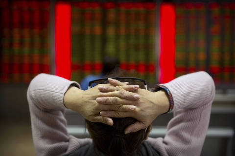 A Chinese investor monitors stock prices at a brokerage house in Beijing, Friday, Feb. 23, 2018. Asian stocks advanced Friday after Wall Street rebounded from a two-day losing streak and Japanese inflation edged higher. (AP Photo/Mark Schiefelbein) ORG XMIT: XMAS104