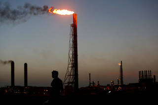 A man stands close to the Cardon refinery which belongs to the Venezuelan state oil company PDVSAn in Punto Fijo