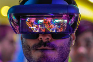 A visitor tries out Lenovo augmented reality glasses with the Star Wars Jedi Challenges during the Mobile World Congress in Barcelona,