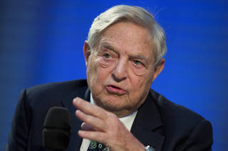 FILE PHOTO: Soros Fund Management Chairman Soros speaks during panel discussion at Nicolas Berggruen Conference in Berlin