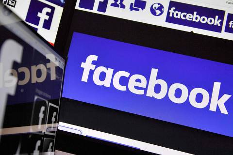 (FILES) This file photo taken on November 20, 2017 shows logos of US online social media and social networking service Facebook. Facebook on February 27, 2018 announced a $3 million pilot project aimed at helping US newspapers boost paid digital subscriptions. The move was the latest by the huge social network to respond to concerns that it and other online platforms have hurt news organizations by dominating internet advertising.   / AFP PHOTO / LOIC VENANCE ORG XMIT: LVE4346